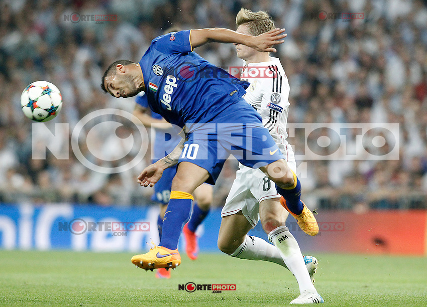 Real Madrid's Toni Kroos (r) and Juventus' Carlos Tevez during Champions League 2014/2015 Semi-finals 2nd leg match.May 13,2015. (ALTERPHOTOS/Acero) /NortePhoto.COM