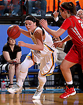BROOKING, SD - NOVEMBER 13:  Ellie Thompson #45 from South Dakota State drives against Morgan Bartner #22 form Marist in the first half of their game Friday night at Frost Arena in Brookings. (Photo by Dave Eggen/Inertia)