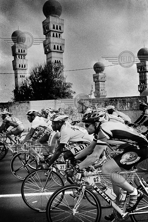 Cyclists on the first stage leaving Dakar..The Tour du Senegal, a two-week cycle race held in average temperatures of 40 degrees Celsius, traverses the country with a total distance of 1168km.