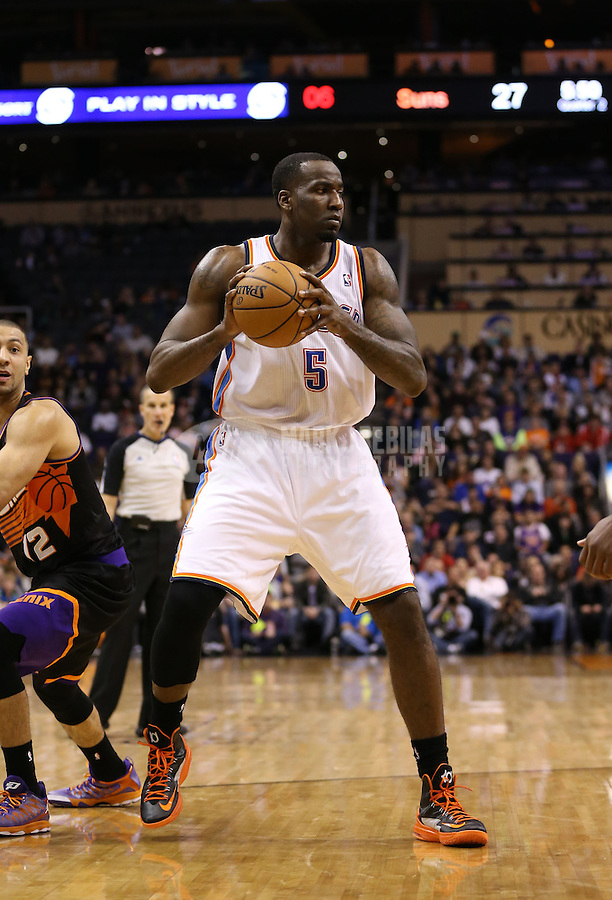 Feb. 10, 2013; Phoenix, AZ, USA: Oklahoma City Thunder center Kendrick Perkins against the Phoenix Suns at the US Airways Center. Mandatory Credit: Mark J. Rebilas-