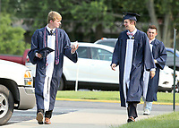 David Schwartz (left) and Jack Behr arrive at CC for the commencement ceremony.