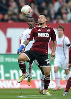 FUSSBALL   1. BUNDESLIGA  SAISON 2012/2013   8. Spieltag 1. FC Nuernberg - FC Augsburg       21.10.2012 Knowledge Musona (li, FC Augsburg) gegen Timo Gebhart (1 FC Nuernberg)