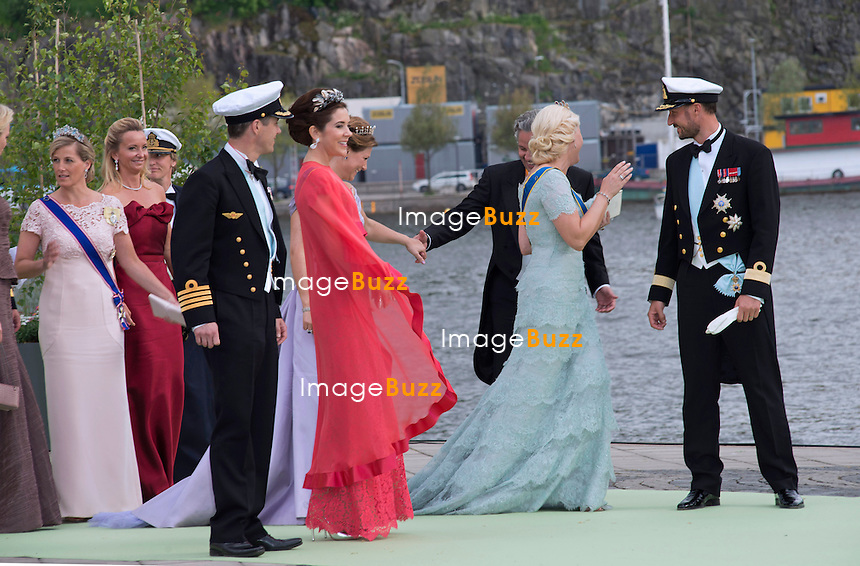 CROWN PRINCE FREDERIK, PRINCESS MARY, PRINCESS MARTHA LOUISE, ARI BEHN, PRINCESS METTE-MARIT AND CROWN PRINCE HAAKON<br /> arrive for a boat ride to Drottingholm Palace for the Wedding Banquet Riddarholmen, Stockholm, Sweden_08/06/2013<br /> Princess Madeleine married Christopher O'Neill at the Royal Chapel, Royal Palace in Stockholm