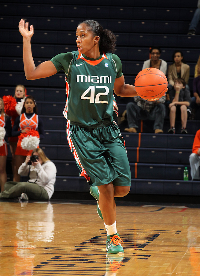 Jan. 6, 2011; Charlottesville, VA, USA; Miami Hurricanes guard Shenise Johnson (42) handles the ball during the game against the Virginia Cavaliers at the John Paul Jones Arena.  Mandatory Credit: Andrew Shurtleff-