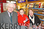 FINAL SALE: Tadhg and Joan Corkery selling their granddaughter Ciara sweets for the last time as their shop in High Street closed on Wednesday..