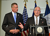 Mayor Bill de Blasio of New York City, right, looks on as NYPD Deputy Commissioner of Intelligence & Counter-terrorism John Miller answers a question during a press briefing following their meetings at the White House with senior officials on the terrorism threat and dealing with the Ebola crisis in Washington, D.C. on Tuesday, October 14, 2014. <br /> Credit: Ron Sachs / CNP<br /> (RESTRICTION: NO New York or New Jersey Newspapers or newspapers within a 75 mile radius of New York City)
