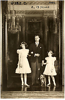 BNPS.co.uk (01202 558833)<br /> Pic: MarcusAdams/ChiswickAuctions/BNPS<br /> <br /> 1939 - War looms - King George in Buckingham Palace with his daughters Princess Elizabeth (13) and Margaret (9)<br /> <br /> Charming childhood photos of Princess Elizabeth and Princess Margaret have come to light, including a previously unseen image of the future Queen in a kilt.<br /> <br /> The portraits, taken by acclaimed British society photographer Marcus Adams, capture the future Queen from being a baby to her adolescence.<br /> <br /> The Queen Mother would often take her daughters to his central London studio where he would set up toys and props to keep them entertained