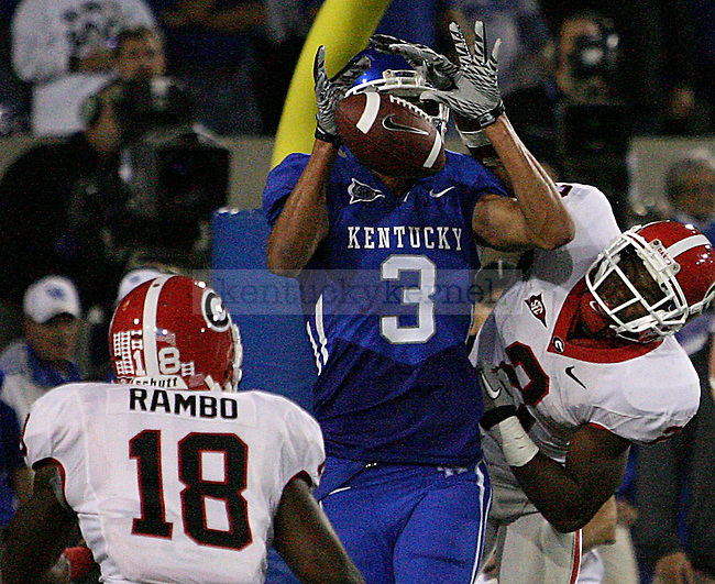 Junior wide receiver Matt Roark catches a ball in the middle of defenders in the second half of UK's home game against the Georgia Bulldogs at Commonwealth Stadium, Saturday, Oct. 23, 2010. Photo by Brandon Goodwin | Staff