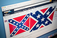 Confederate flag products for sale on the Amazon website are seen on Tuesday, June 23, 2015. In lieu of the South Carolina controversy major retailers such as Amazon, Walmart and Sears and eBay will stop selling Confederate battle flag merchandise. (© Richard B. Levine)