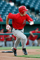 Mike Trout ---  AZL Angels - 2009 Arizona League.Photo by:  Bill Mitchell/Four Seam Images.Anaheim Angels 1st round pick Mike Trout made his professional debut in an Arizona League game against the Rangers at Tempe Diablo Stadium on Sunday, July 5, 2009. Trout hit a triple in his first at bat and finished the game 2 for 2 with 4 walks. The Angels defeated the Rangers, 18-3. In this photo, Trout is heading to first base en route to third for his first professional hit.
