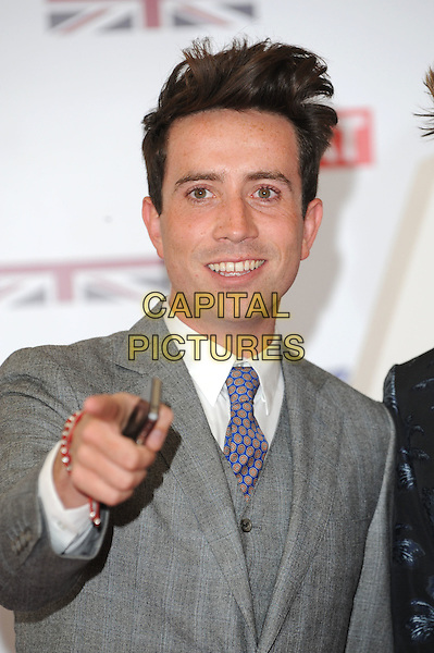 Nick Grimshaw.The UK Creative Industries Reception supported by The Founders Forum, at the Royal Academy of Arts, London, as part of HM Government's GREAT campaign alongside the very best of the UK Creative Industries from the fields of music, film, art and entertainment..30th July 2012 .half length grey gray suit jacket hand arm finger pointing .CAP/BEL.©Tom Belcher/Capital Pictures.