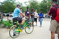 Michael Seymour, a professor in MSU's Department of Landscape Architecture, shows students one of the LIME bikes used in the campus' new bike share program. Seymour is leading a First-Year Experience seminar titled &quot;Bike to the Future&quot; on the health, environmental and economic benefits of biking. The LIME bike share program allows students to rent a bike for 50 cents and pay using the LIME smartphone app. For more information on the bike share program, visit www.limebike.com or contact MSU Parking and Transit Services.<br />  (photo by Marco Lopez / &copy; Mississippi State University)