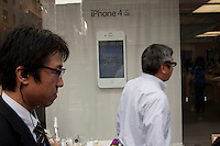 Point of sale details showing the iphone 4S at the Apple store during the official release of the iphone4S in Ginza, Tokyo, Japan. Friday October 14th 2011. The latest version of the popular iphone was released worldwide on October 14th. Japans flagship Apple store in Ginza was opened at 8am for the 800 people that had been waiting to be the first to purchase the new telephone.