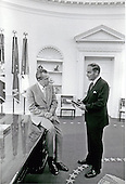Washington, D.C. - May 23, 1974 -- United States President Richard M. Nixon, left, gives instructions to his Chief of Staff, General Alexander M. Haig, United States Army, right, who is taking notes, in the Oval Office in the White House in Washington, D.C. on May 23, 1974..Credit: White House via CNP