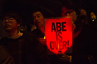 "Hundreds of students and other activists hold candles and signs, some reading ""Abe is Over"" as they  protest outside the Japanese Prime Minister's office calling on the Japanese Prime Minister, Shinzo Abe and Finance Minister, Taro Aso to resign over a suspected cover-up of the Moritomo Gakuen school  land sale scandal and falsified documents. Kasumigaseki, Tokyo, Japan Friday, March 23rd 2018"