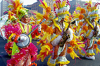 parade, costume, band, Philadelphia, PA, Pennsylvania, Members of a String Band dressed in fancy colorful costumes with feathers play their instruments and strut in the Mummers Day Parade on New Years Day in Philadelphia.