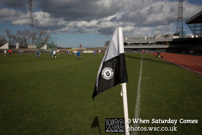 Edinburgh City v Spartans, 11/04/2015. Commonwealth Stadium, Scottish Lowland League. A corner flag with club logo at the Commonwealth Stadium at Meadowbank during the Scottish Lowland League match between Edinburgh City (white shirts) and city rivals Spartans, which was won by the hosts by 2-0. Edinburgh City were the 2014-15 league champions and progressed to a play-off to decide whether there would be a club promoted to the Scottish League for the first time in its history. The Commonwealth Stadium hosted Scottish League matches between 1974-95 when Meadowbank Thistle played there. Photo by Colin McPherson.