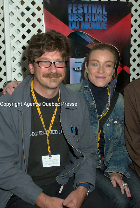 Aug 24 2002, Montreal, Quebec, Canada<br /> <br /> Alessandro d'Alatri (L)  and the actress Stefania Rocca (R)<br /> pose for photographers before the Press conference for the italian movie Casomai, presented in the Official Competition of the 26th World Film Festival.<br /> , Au g23 2002, in  Montreal, Quebec, Canada<br /> <br /> Born in Rome in 1955, Alessandro D'Alatri made his showbusiness debut at the age of eight acting in a production of The Cherry Orchard directed by Luchino Visconti. Before long, he was a veteran, playing roles in the theatre, on television and in the movies. The latter included roles in De Sica's GARDEN OF THE FINZI-CONTINIS and films by Valerio Zurlini and Ettore Scola. He began directing commercials and eventually became one of Italy's top directors of advertising films, earning prizes worldwide. He made his directorial debut in features with AMERICANO ROSSO (1991), which won that year's David di Donatello Prize for best first film in Italy. His 1994 feature, NO SKIN, was shown at the Montreal World Film Festival, and he directed THE GARDEN OF EDEN in 1998. <br /> <br /> <br /> Mandatory Credit: Photo by Pierre Roussel- Images Distribution. (&copy;) Copyright 2002 by Pierre Roussel <br /> <br /> NOTE : <br />  Nikon D-1 jpeg opened with Qimage icc profile, saved in Adobe 1998 RGB<br /> .Uncompressed  Uncropped  Original  size  file availble on request.