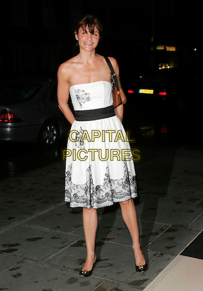 HELENA CHRISTENSEN.Attends Suka, An evening at Sanderson in aid of CLIC Sargent, The Sanderson, Berners Street,.London, England, May 15th 2007..full length strapless white black lace dress sash brown bag fringe flat pumps shoes.CAP/AH.©Adam Houghton/Capital Pictures.
