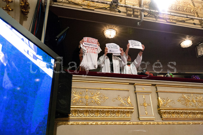 Healthcare protesters inside theater