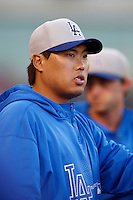 Hyun-Jin Ryu #99 of the Los Angeles Dodgers watches a game against the Los Angeles Angels in both teams final spring training game at Angel Stadium on March 30, 2013 in Anaheim, California. (Larry Goren/Four Seam Images)