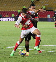 BOGOTA -COLOMBIA- 29 -09-2013. Juan Roa (Der) de Independiente Santa Fe  disputa el balon contra Amilkar Henriquez (Izq)  del Independiente Medellin  , partido correspondiente a la doceava fecha de La Liga Postobon segundo semestre jugado en el estadio Nemesio Camacho El Campin / Juan Roa (R) of Independiente Santa Fe dispute the ball against Amilkar Henriquez (L) of Independiente Medellin, the twelfth game in La Liga Postobon date second half played in the Estadio Nemesio Camacho El Campin  .Photo: VizzorImage / Felipe Caicedo / Staff