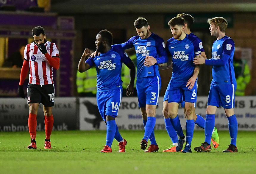 Peterborough United's Junior Morias, left, celebrates after his cross lead to the opening goal<br /> <br /> Photographer Chris Vaughan/CameraSport<br /> <br /> The EFL Checkatrade Trophy Fourth Round - Lincoln City v Peterborough United - Tuesday 23rd January 2018 - Sincil Bank - Lincoln<br />  <br /> World Copyright &copy; 2018 CameraSport. All rights reserved. 43 Linden Ave. Countesthorpe. Leicester. England. LE8 5PG - Tel: +44 (0) 116 277 4147 - admin@camerasport.com - www.camerasport.com