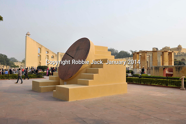 Jantar Mantar in Jaipur is a collection of architectural astronomical instruments built by Jai Singh II between 1728 and 1734.The largest instrument is the Brihat Samrat Yantra it has a 75 foot high gnomon set at an angle of 27 degrees. It is the biggest sun dial in the world, accurate to about 2 seconds local time,it is still in use by astrologers to aid in the prediction of the monsoon rains, and subsequent success or failure of crops.