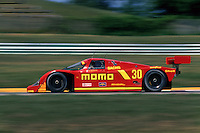 ELKHART LAKE, WI - AUGUST 25: The MOMO/Gebhardt Racing Porsche 962C of Gianpiero Moretti and Derek Bell is driven during the Nissan Grand Prix of Road America IMSA GTP/Lights race at the Road America track near Elkhart Lake, Wisconsin, on August 25, 1991.