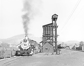 #492 and another loco at Durango coaling tower.  Gondola #878 on coaling supply lead.<br /> D&amp;RGW  Durango, CO  Taken by Grenard, Ross B.