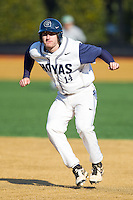 Jake Kuzbel (14) of the Georgetown Hoyas takes his lead off of first base against the Marshall Thundering Herd at Wake Forest Baseball Park on February 15, 2014 in Winston-Salem, North Carolina.  The Thundering Herd defeated the Hoyas 5-1.  (Brian Westerholt/Four Seam Images)