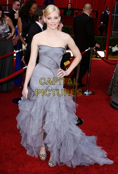 ELIZABETH BANKS .The 82nd Annual Academy Awards held aat The Kodak Theatre in Hollywood, California, USA..March 7th, 2010.oscars full length strapless hand on hip grey gray dress ruffles ruffles silk chiffon layers layered flamenco purple platform sandals.CAP/EAST.©Eastman/Capital Pictures.
