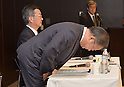 May 14, 2013, Tokyo, Japan - Takashi Okuda, left, outgoing president of Japan's Sharp Corp., takes a deep bow at the start of a news conference in Tokyo on Tuesday, May 14, 2013. Okuda will be replaced by Kozo Takahashi, currently an executive vice president, as of June 25 in a reshuffle to help restore profitability after reporting a record loss of $5.4 billion in the fiscal year that ended in March. (Photo by Natsuki Sakai/AFLO)