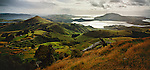 View from Peggys Hill looking over farmland and hills on Otago Peninsula. New Zealand.