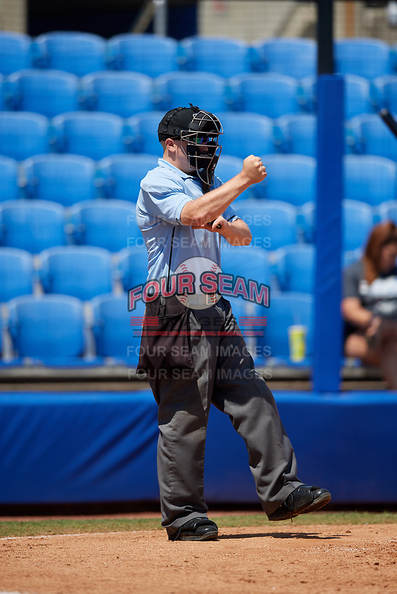 Home plate umpire Matt Carlyon calls a batter out on strikes during a game between the Daytona Tortugas and the Dunedin Blue Jays on April 22, 2018 at Dunedin Stadium in Dunedin, Florida.  Daytona defeated Dunedin 5-1.  (Mike Janes/Four Seam Images)