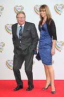 Jim Davidson and wife Michelle arriving for the Health Lottery Tea Party, The Savoy, London. 02/06/2014 Picture by: Alexandra Glen / Featureflash