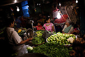 Local Mumbaikars are seen buying vegetables and daily need items from a local market in the suburbs of Mumbai. Inflation in the recent times in India has gone up to 12%.