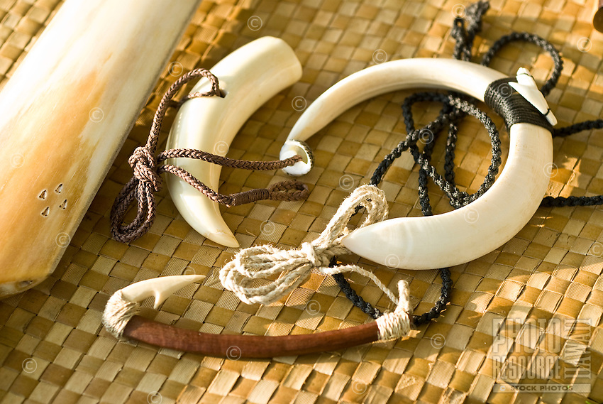 A makau (fish hook) and necklaces made from niho pua'a (pig's tusk) by artisan UMI KAI.