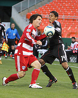 Andy Najar #14 of D.C. United clashes with Zach Loyd #19 of F.C. Dallas during a US Open Cup match on April 28 2010, at RFK Stadium in Washington D.C. United won 4-2.