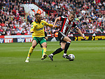 Tom Trybull of Norwich City in action with Paul Coutts of Sheffield Utd during the Championship match at Bramall Lane Stadium, Sheffield. Picture date 16th September 2017. Picture credit should read: Jamie Tyerman/Sportimage