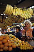 Belgrade, Serbia, Yugoslavia. Woman in an orange gilet buying fruit at the market.