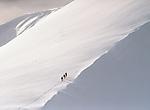 Trekking up snowy mountain