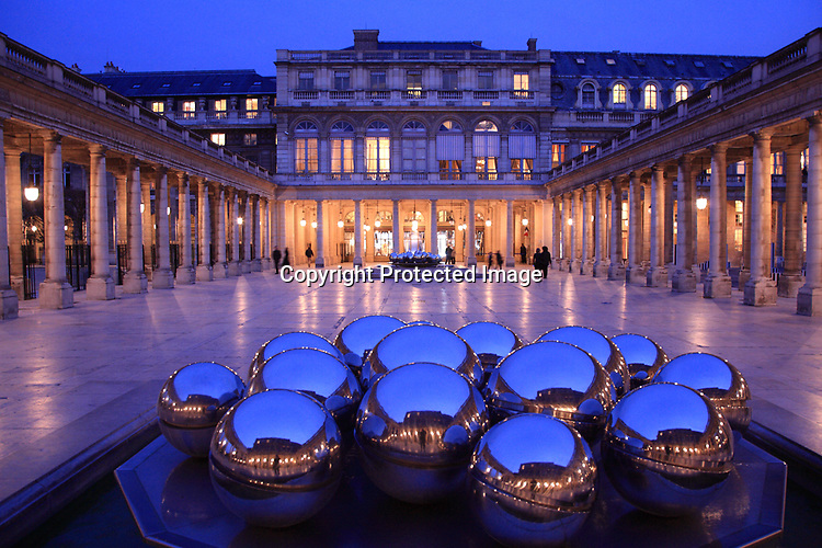 The night view of Paul Bury Fountain in courtyard of Palais Royal. Paris. city of Paris. France