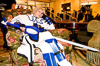 "Tara, cos-playing as Kykiske, takes a break in the hotel lobby at the 12th annual Katsucon, a convention for fans of Japanese comics, animation (anime), and video games, held in Washington D.C. on February 18, 2006 and attended by over 8,000 people.<br /> <br /> Cosplay, short for ""costume play"", is the act of creating and wearing outfits of one's favorite anime, comic, or video game and often acting out that characters actions."