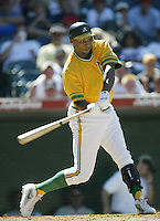 Jermaine Dye of the Oakland Athletics bats during a 2002 MLB season game against the Los Angeles Angels at Angel Stadium, in Anaheim, California. (Larry Goren/Four Seam Images)