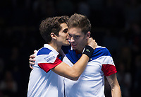 Nicolas Mahut (right) and Pierre-Hugues Herbert of France celebrate their victory over Jean-Julien Rojer of Netherlands and Horia Tecau of Romania in their Doubles Group Elthing / Haarhuis match today - Mahut/Herbert def Rojer/Tecau 1-6, 7-6, 10-8<br /> <br /> Photographer Ashley Western/CameraSport<br /> <br /> International Tennis - Barclays ATP World Tour Finals - O2 Arena - London - Day 1 - Sunday 12th November 2017<br /> <br /> World Copyright &not;&copy; 2017 CameraSport. All rights reserved. 43 Linden Ave. Countesthorpe. Leicester. England. LE8 5PG - Tel: +44 (0) 116 277 4147 - admin@camerasport.com - www.camerasport.com