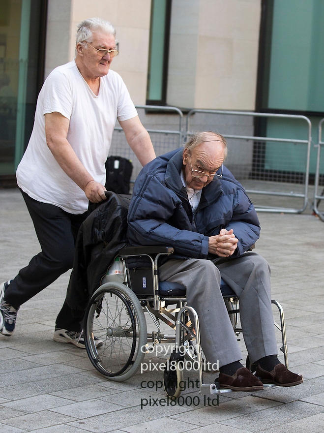 Westminster magistrates court in London 4.9.13<br /> <br /> pic shows: co-accused John Stingemore, 71, a care home manager  (in wheelchair)  - was charged with eight counts of indecent assault, two of taking indecent images of a child and one count of conspiracy to commit buggery. <br /> <br /> <br /> <br /> seen here attacking photographer outside court.<br /> <br /> <br /> He appeared with Priest Anthony McSweeney lappearing  sex offence charges.<br /> <br /> A Roman Catholic priest from Norfolk is charged on suspicion of sexual offences. He has stood down from the Ministry while investigations are carried out. 66-year-old Father Tony McSweeney - has also resigned as director of one of the biggest schools in Norwic<br /> <br /> Pic by Gavin Rodgers/Pixel 8000 Ltd