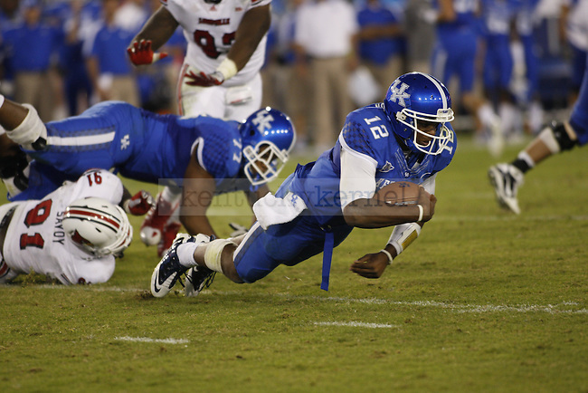 UK quarterback Morgan Newton falls to the ground during the second half of UK's home game against Louisville, Saturday, Sept. 17, 2011 in Lexington, Ky.  Photo by Brandon Goodwin | Staff