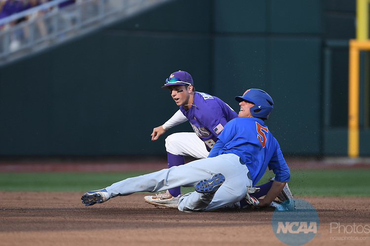OMAHA, NE - JUNE 26: Dalton Guthrie (5) of the University of Florida looks to the umpire for the call after being tagged by Cole Freeman (8) of Louisiana State University during the Division I Men's Baseball Championship held at TD Ameritrade Park on June 26, 2017 in Omaha, Nebraska. The University of Florida defeated Louisiana State University 4-3 in game one of the best of three series. (Photo by Jamie Schwaberow/NCAA Photos via Getty Images)