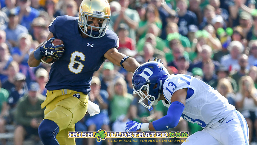 Irish wide receiver Equanimeous St. Brown (6) runs after the catch as Duke Blue Devils safety Jordan Hayes (13) attempts to tackle in the first quarter.